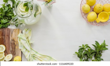 Tray with  traditional lemonade with fresh sliced lemons and mint.