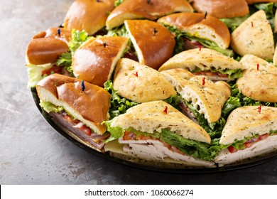 Tray of turkey and ham sandwiches ready to be delivered