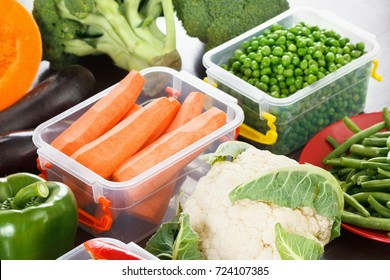 Trays box with vegetables for freezing. Stocking up for winter storage in plastic containers