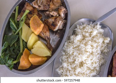 Trays of rice and chicken with vegetables, very typical food of the islands of Cape Verde