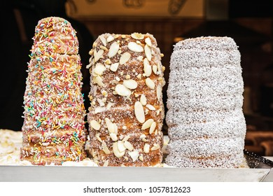 Trdelnik is a kind of spit cake. It is made from rolled dough that is wrapped around a stick, then grilled and topped with sugar and walnut mix.