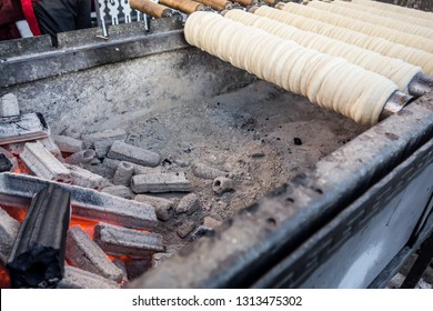 Trdelnik (or trdlo) - famous Czech buns made from sweet dough with fragrant sprinkling of cinnamon, nuts and sugar. Bake trdelnik on an open fire, on cylindrical spits of wood, usually beech, or metal