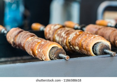 Trdelnik is street food of Prague. It considered a traditional national Czech sweet food. Trdlo is tubes of sweet dough, cooked on an open fire