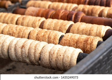 Trdelnik is street food of Prague. It considered a traditional national Czech sweet food. Trdelnik is tubes of sweet dough, cooked on an open fire. Selective focus.