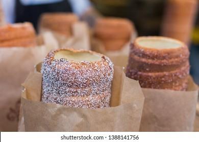 Trdelnik or Trdlo or Kurtosh Kalach being baked in a street bakery in Budapest