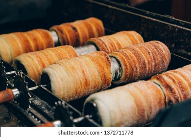 Trdelnik (Trdelník) or trdlo on a showcase shop in Prague,  Kind of spit cake it is made from rolled dough that is wrapped around a stick then grilled and topped with sugar and walnut mix.