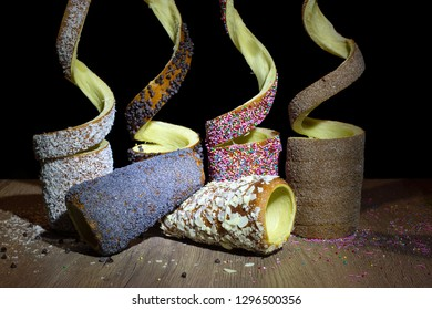 Trdelnik or trdlo is traditional czech, hungarian and slovak sweet hollow roll pastry dough covered with sugar, chocolate, almond, cinnamon or poppy