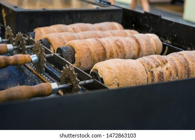 Trdelnik or Trdlo (traditional czech sweet treat)  being baked in a street bakery. It is a popular dish among tourists. Horizontal view
