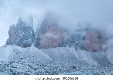 Tre Cime di Lavaredo in beautiful surroundings in the Dolomites at foggy winter weather in Italy, Europe (Drei Zinnen)