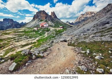 TRE CIME DI LAVAREDO, ITALY - June 30th, 2018: Beautiful landscape of Tre Cime di Lavaredo National park with Rifugio Locatelli mountain refuge