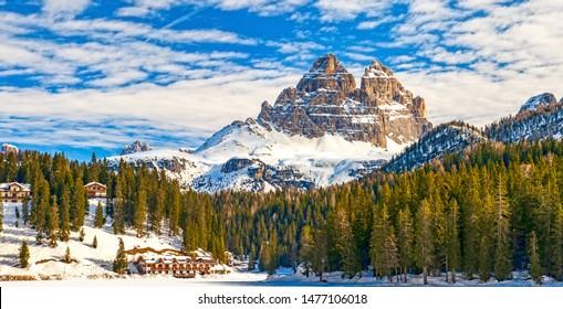 Tre Cime di Lavaredo peaks seen from Misurina lake in Dolomites, Italy in winter, Belluno / Trentino Alto Adige border
