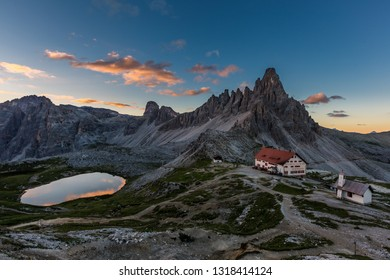 Tre Cime and  rifugio hut before sunrise, Tre Cime di Lavaredo National Park, Dolomites, Italy
