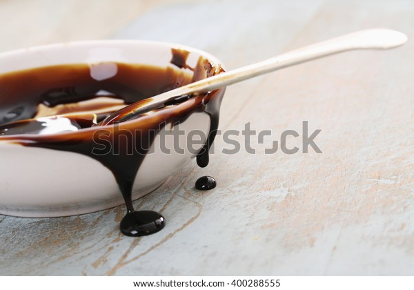 treacle dripping from dish with spoon