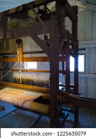Treadle operated loom (circa 1886) that utilized cards with punched holes (similar to early computer punch cards) in which each card corresponded to a line in the completed weaving pattern.