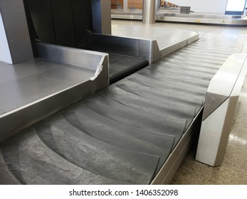 Treadmill of the airport baggage carousel. Baggage delivery.