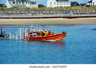 Trearddur Bay's Atlantic 85 class lifeboat on Anglesey in North Wales, prepares for beach launch on training exercise on the evening of 5th July 2018