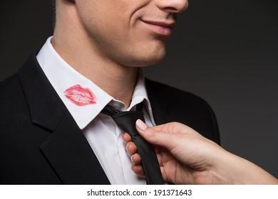 Treason. Man with lipstick on his collar
