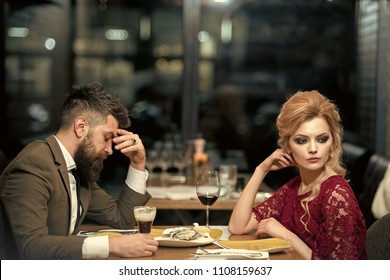 treason and resentment. Bad date of couple, break up relations and love. couple with misunderstanding at restaurant. Business meeting of man and woman. Valentines day with woman and man. Dislike makes