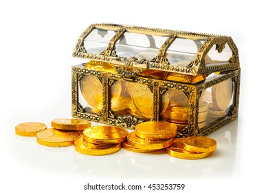 Treasure chest with golden coins isolated on white