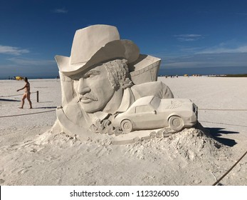 "TREASURE ISLAND / CLEARWATER, FLORIDA USA 12-27-17 This artistic sand sculpture competition entry on a Gulf Coast beach depicts Burt Reynolds & his Trans Am car from the movie ""Smokey and the Bandit"""