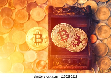 Treasure of metal Bitcoins over the coin background.  Coffer with Digital BitCoin BTC Currency Technology concept.
