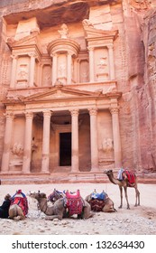 The treasury (Al-Khazneh) with camels ready to transport tourists from Petra in Jordan