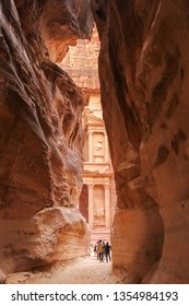 The Treasury cliff temple viewed from the Siq gorge entrance, Petra, Jorda