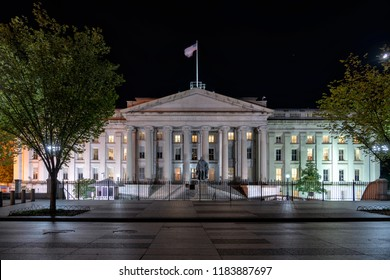 The Treasury Department in Washington DC at night with Albert Gallatin Statue from Pennsylvania Avenue