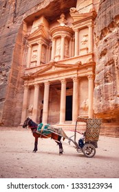 The Treasury temple (Al Khazneh) and a horse drawn-cart used for tourist transportation, Petra Jordan