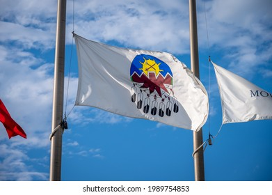 Treat 7 Flag in Alberta at half mast, blue sky background.