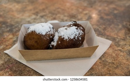 A treat called oliebollen in dutch, which is traditional sweet food for New Year's eve in the Netherlands