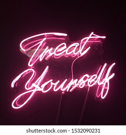 Treat Yourself cursive pink neon sign