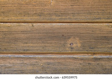 Treated wooden boards - wood decking flooring and wood deck with paneled walls. Textures and patterns of natural wood. Background for interiors and modern design ideas