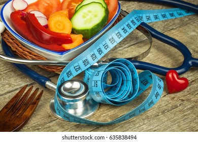 Treatment of obesity. Diet on a wooden table. Healthy vegetables
