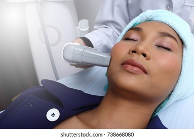 Treatment on Asian Woman as patient to make skin smooth bright and cure acne with medical beauty device instrument cold process on face in hospital medical clinic