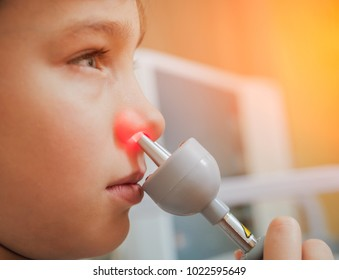 Treatment and warming-up the nose of a young boy. Modern Pediatrics. Physiotherapy