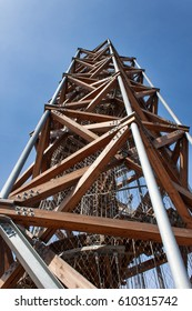 """TREBIC, CZECH REPUBLIC - MARCH 25, 2017: Lookout tower on """"Pekelny kopec"""" near the town Trebic. Built in 2014. The wooden structure of larch wood with metal elements. The tower is 26.5 meters high"""