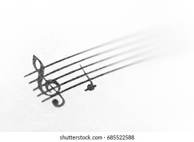 treble clef and music note on paper