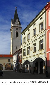 TREBON, CZECH REPUBLIC - APRIL 29, 2012: Street and Church of Our Lady of Queen and St. Giles of Trebon. Trebon is a old historical town in South Bohemian Region