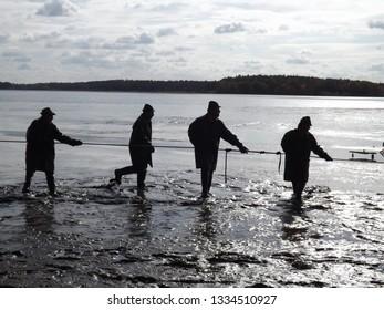 Trebon, Czech Republic - Oktober 13, 2017: Fishermen fish out the Rozmberk pond in Trebon, Czech Republic