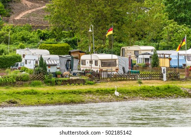 Trechtingshausen, Germany - May 23, 2016: Camping Marienort in Trechtingshausen near Reichenstein castle in cloudy weather, Rhine Valley, Rhineland-Palatinate, Germany.