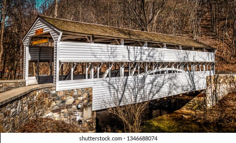 TREDYFFRIN TOWNSHIP, PENNSYLVANIA – FEB 19, 2019: Historic Knox Bridge spans over Valley Creek in Valley Forge National Historic Park in Chester County.