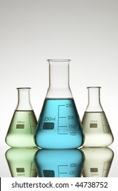 tree beakers with color liquid