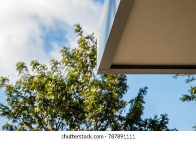 Tree behind a corner