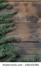 Tree branch on rustic wooden background used for christmas decoration