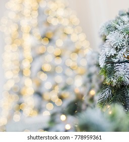 Tree and Christmas decorations. Beautiful decorated with present boxes in a winter landscape with snow.