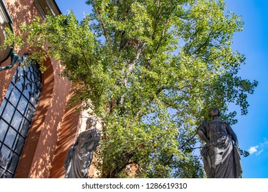 Tree Covered in Foliage Framed by Two Saint Statues outside of the Storkyrkan Stockholm Cathedral in the Gamla Stan Neighborhood of Stockholm, Sweden