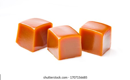 Tree cubes of caramel on white background. Isolated