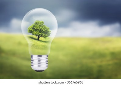 Tree in electric lamp. Ecological energy concept