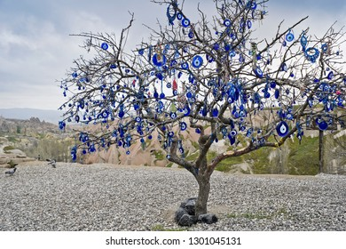 Tree full of dangling evil eye charms (nazar), Pigeon Valley, Cappadocia, Turkey